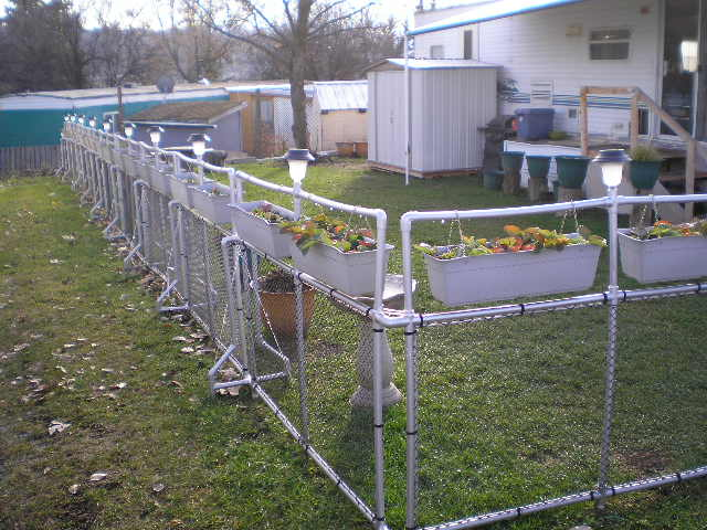 Plans for a pvc yard fence with hanging planters